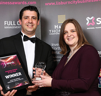 Philip received the award from Susan Dunlop of Hanna Thompson Chartered Accountants