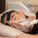Fig 3 - Continuous positive airway pressure (CPAP) machine in use