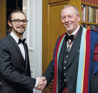 Competition winner David Cobbett with Professor Fraser McDonald