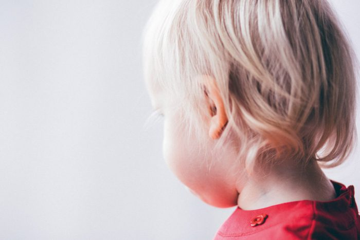 Child looking away from camera