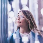 Woman looking thoughtful in blurred lighting